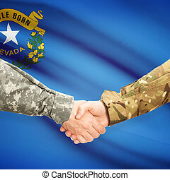 Soldiers handshake and US state flag - Nevada