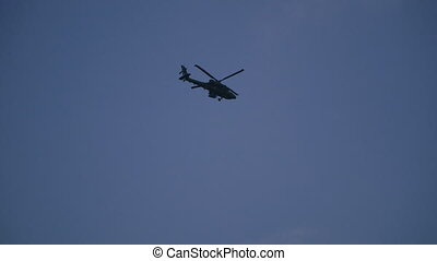 Military helicopter flies against the blue sky. South Korea. Seoul
