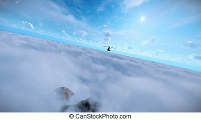 Military helicopter flying over clouds, ocean and mountain peaks