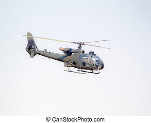 military helicopter in flight