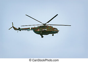Military helicopter landing at sunny day time.