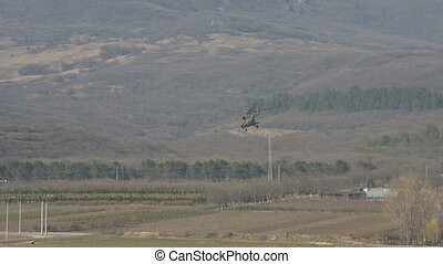 Military helicopter of the Russian Air Force takes off...