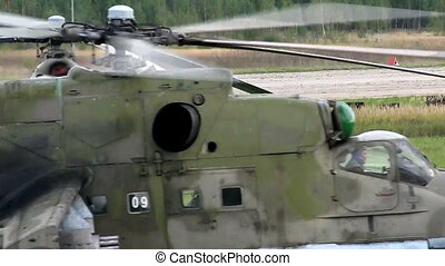 military helicopter on air-base in motion