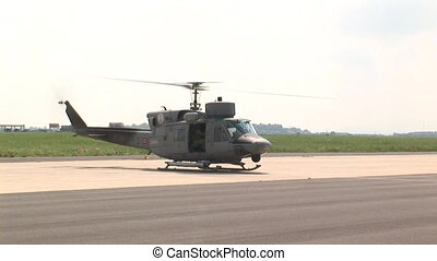 Military helicopter on the runway