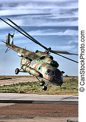 Military helicopter over land