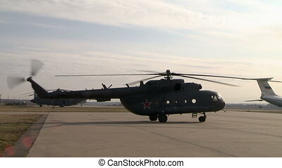 Military helicopter prepares for takeoff - View of military...