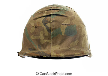 A military helmet of camouflage on white background. Shallow DOF