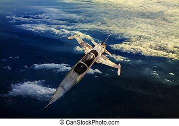 military jet plane flying over moun