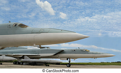 Military jet supersonic aircraft in the parking of the...