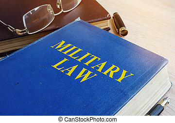 Military Law code on a desk.