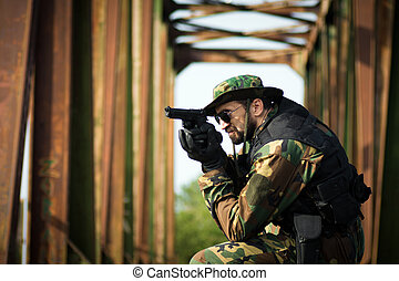 military man aiming with pistol