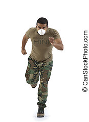Military man in camouflage fatigue running with H1N1 mask action hero style. Nikon D90 85mm f/1.4 Nikkor lens