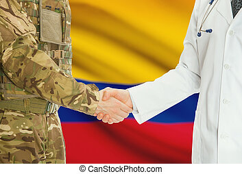 Military man in uniform and doctor shaking hands with national flag on background - Colombia