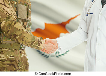 Military man in uniform and doctor shaking hands with national flag on background - Cyprus