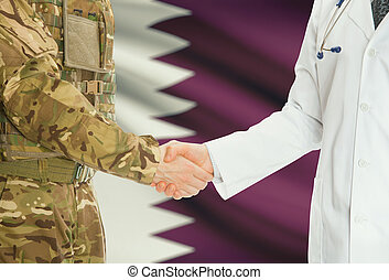 Military man in uniform and doctor shaking hands with national flag on background - Qatar