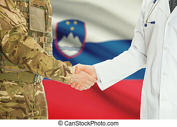 Military man in uniform and doctor shaking hands with ...