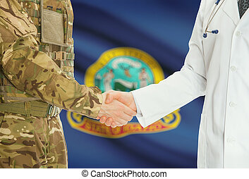 Military man in uniform and doctor shaking hands with US...