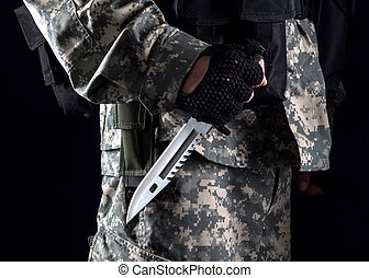 Military man with a knife in a hand