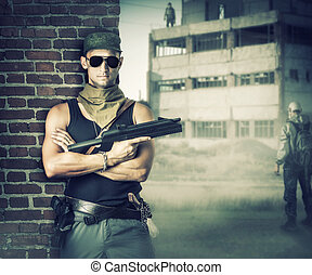 Military man with gun - automatic stay about brick wall in post apocalyptic world
