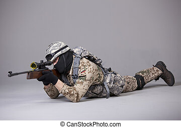 Military man with sniper rifle