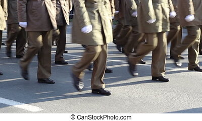 Military Marchpast Close Up - Close-up shot with soldiers in...