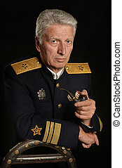 Military mature general over a dark background