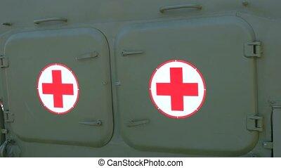 Military medical ambulance close up. Medical evacuation vehicle. Army medical transport.