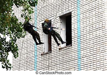 Military men storm a building