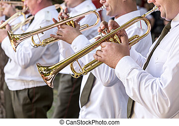 military musicians blowing gold trumpets