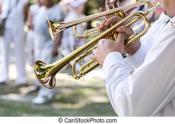 military musicians playing on trumpets in army brass band