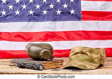 Military necessities in american flag background.