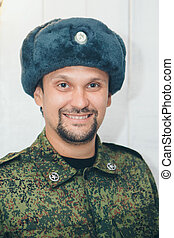military officer in Russian winter uniform. Portrait of a man on a white background in military uniform