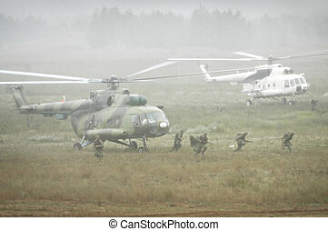 Soldiers landing from helicopters