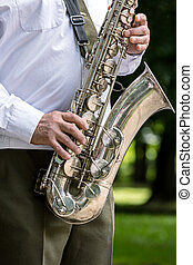 military orchestra musician playing saxophone on music festival
