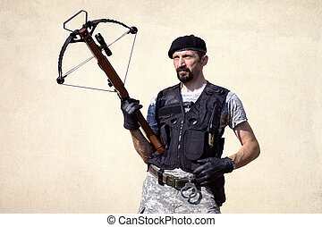 military person with crossbow