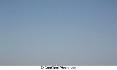 military plane flies overhead close