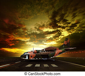 military plane on airport runway against beautiful sun rising sky