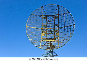 Military radar station against the clear blue sky