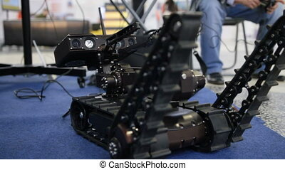 Military robot for discovery and searching on the remote control - moves the manipulators, close up