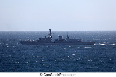 Military ship - a destroyer - in the sea