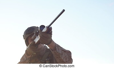 Military sniper takes aim at the optical sight. Airsoft