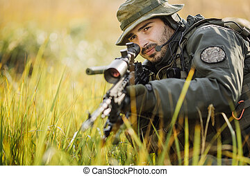 military soldier aiming an assault rifle