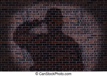 Military soldier saluting, shadow on a brick wall.