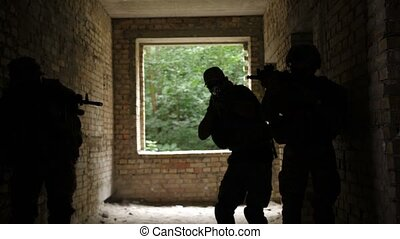 Military soldiers storming the enemy building - Squad of...