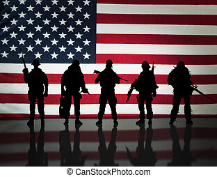 Military special forces in front of an American flag