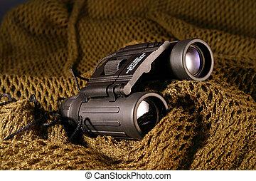 Military spyglass - A military black spyglass laid on a...