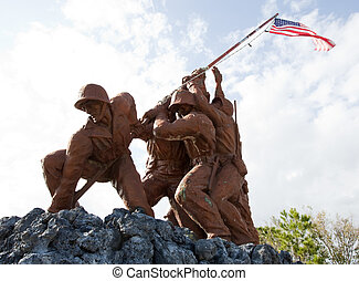 Military statues planting the flag at a verteran's park