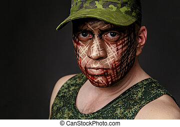 Military Style Camouflage on the Soldier's Face