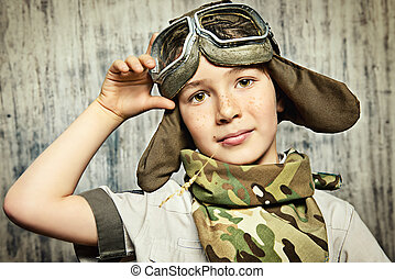 military style - Close-up portrait of a happy kid who dreams...