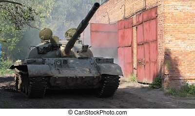 Military tank driving on road slow motion. War tank on...